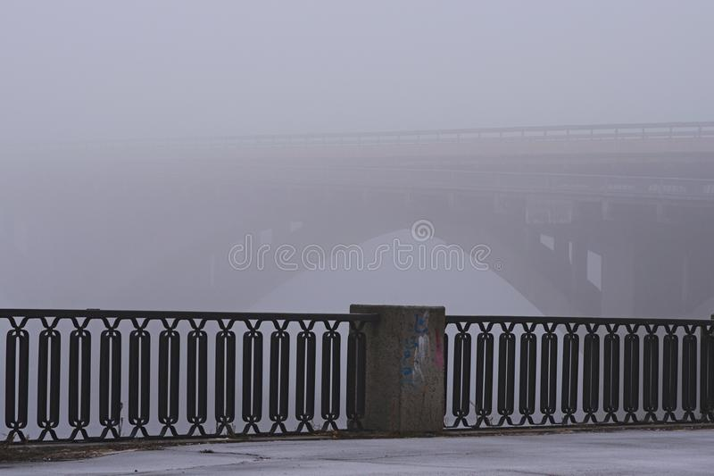Embankment along the Dnieper river. Stone Metro subway bridge in rich fog, mist background. Winter morning view. Kyiv, Ukraine stock photos