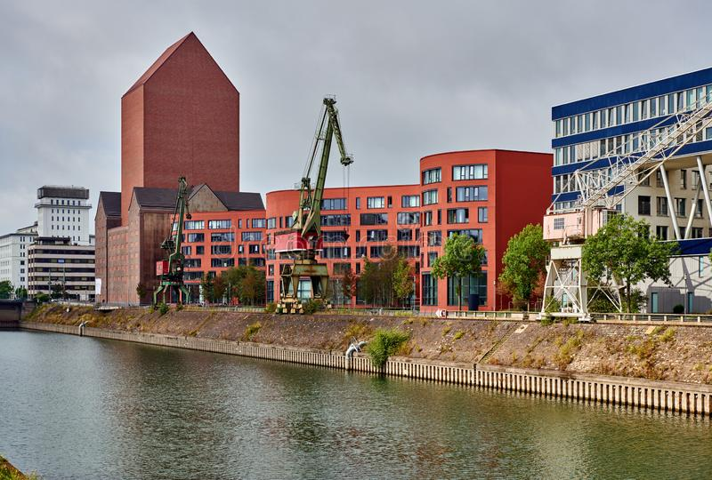 Embankment in Duisburg, Germany. Embankment with modern buildings in Duisburg, Germany royalty free stock image