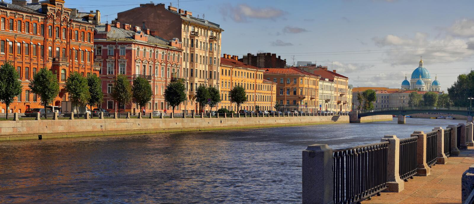 Embankment of the Fontanka river and Trinity Cathedral in Saint-Petersburg stock photography