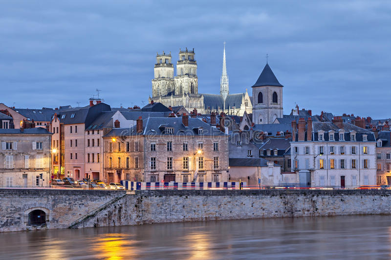Embankment of Loire and Orleans Cathedral. Embankment of Loire river and Orleans Cathedral in the evening, Orleans, France royalty free stock image