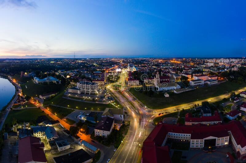 The embankment, the Neman river and the Old bridge in Grodno. Autumn ,evening, the city in the sunshine against a stock photo