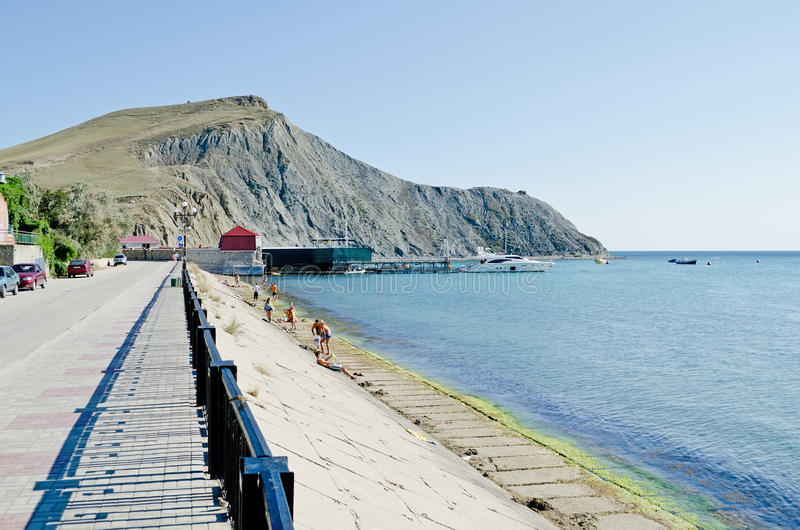 Embankment in Ordzhonikidze. FEODOSIA, UKRAINE - AUGUST 19: In the Crimea, in Ordzhonikidze is constructed the yacht-club on August 19, 2013 in Ordzhonikidze stock image