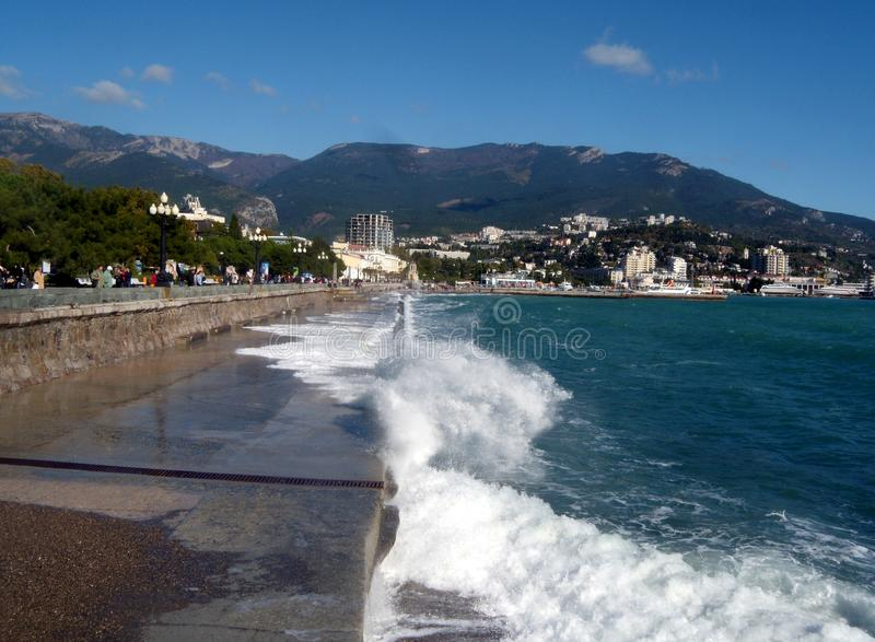 Embankment of the resort Yalta in the autumn afternoon, Crimea, Russia. Autumn day, the Crimea peninsula. View of the Bay royalty free stock photos