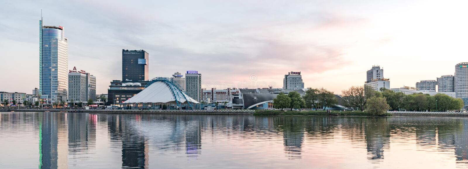 Embankment of the Svisloch River. Panorama of the city center at sunset. stock image