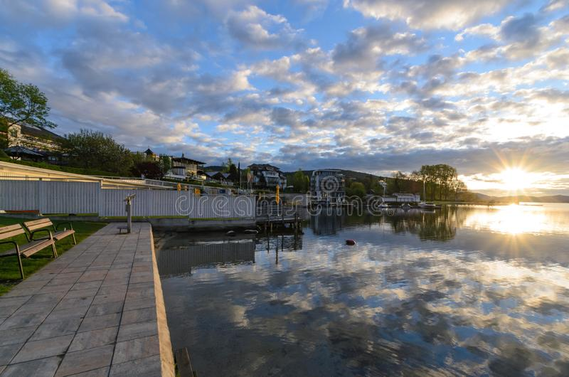 Embankment in Velden am Worthersee during sunrise stock image