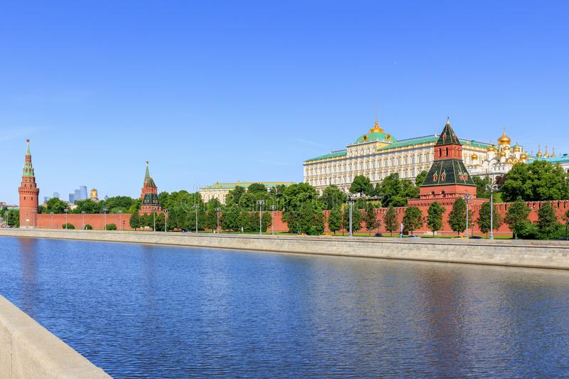 Embankments of Moskva river against Moscow Kremlin in sunny summer morning stock photography