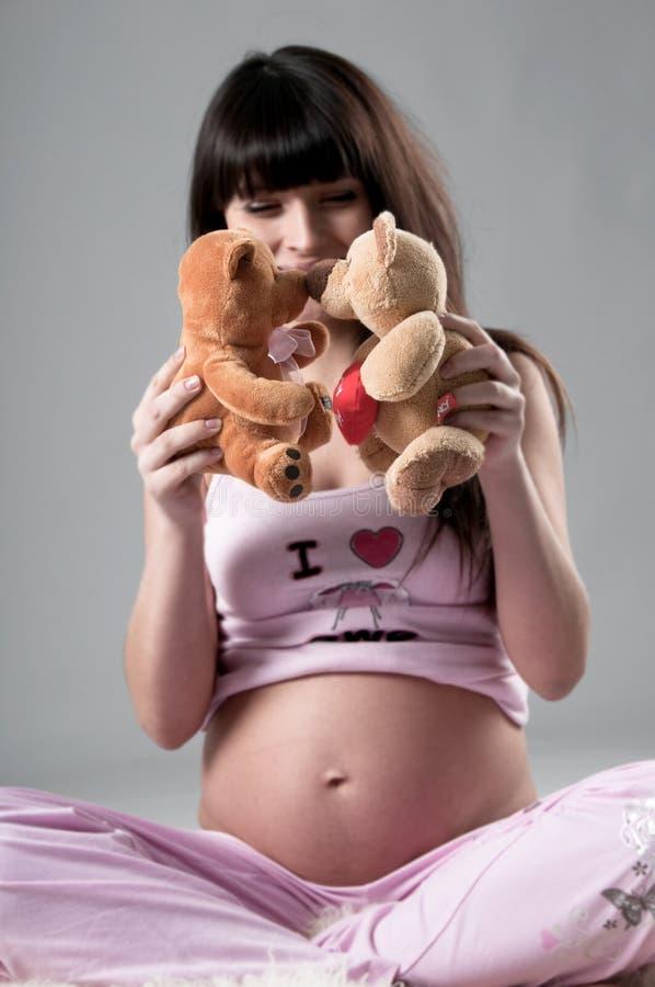 Embarazado con el oso fotos de archivo libres de regalías