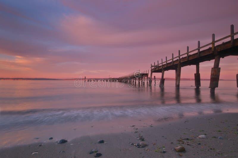 Embarcadero en la puesta del sol imágenes de archivo libres de regalías