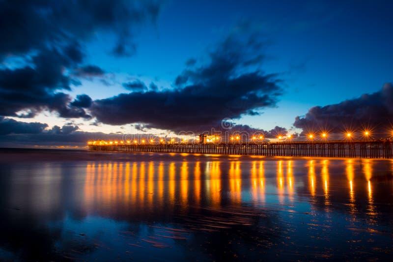 Embarcadero en la puesta del sol foto de archivo libre de regalías