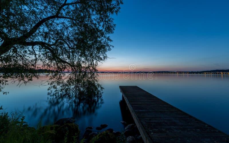 Embarcadero y puesta del sol foto de archivo libre de regalías