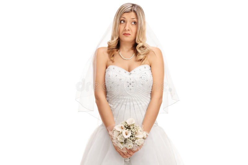Embarrassed bride with a wedding flower royalty free stock photo