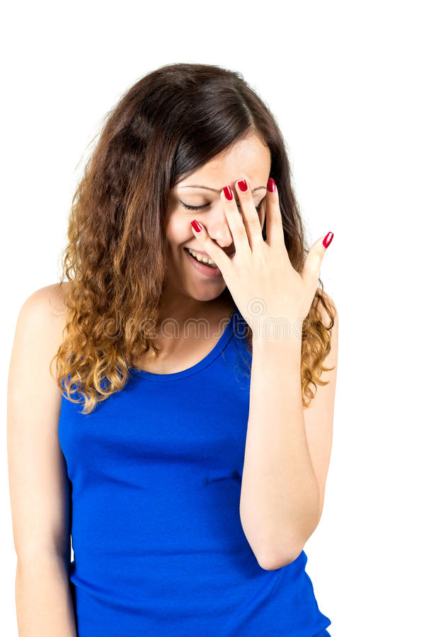 Embarrassed girl covers her face with palm stock photography