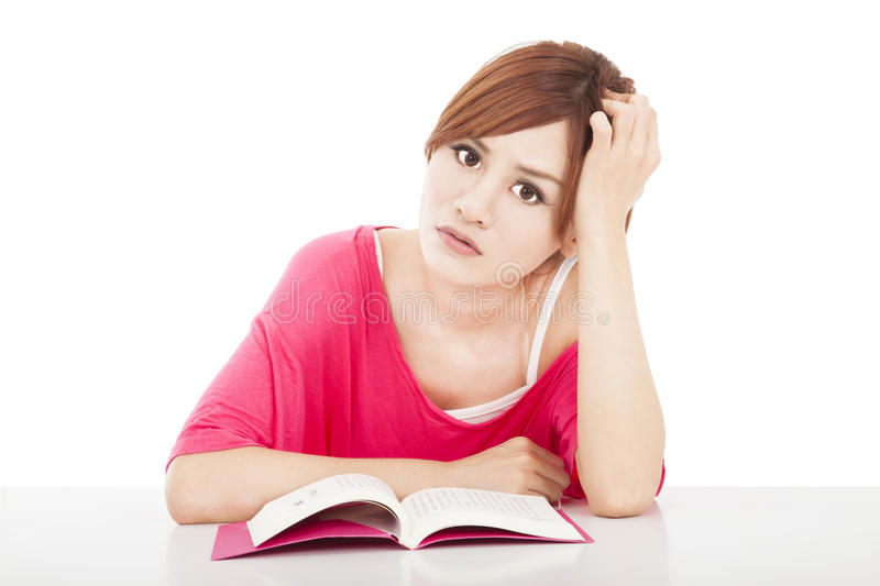 Embarrassed  Girl Studying With Book Royalty Free Stock Photography