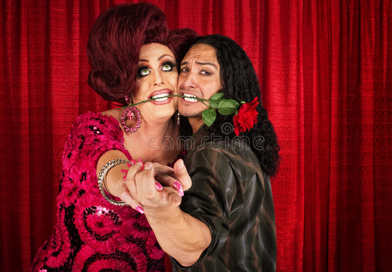 Embarrassed Man Dancing with Transvestite stock images