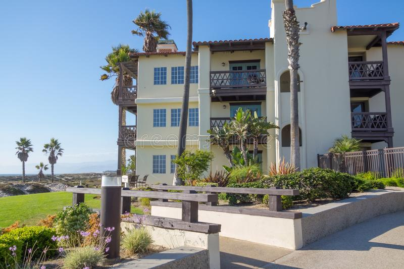 Embassy Suites Mandalay Beach Hotel & Resort. OXNARD, CA - AUGUST 21, 2014: Beach front and ocean facing Mexican style building at Embassy Suites Mandalay Beach royalty free stock images