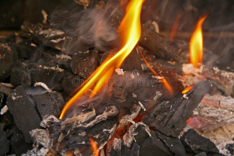 Embers for the barbecue. Preparation of embers to cook a barbecue in the garden of house royalty free stock images