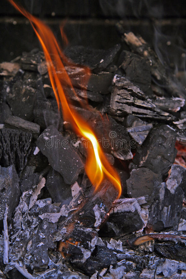 Embers for the barbecue. Preparation of embers to cook a barbecue in the garden of house stock photo