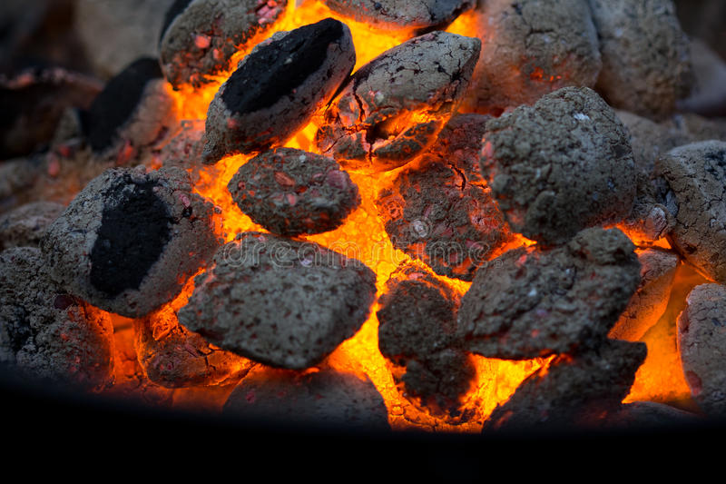 Embers of coal. Glowing in a grill royalty free stock images
