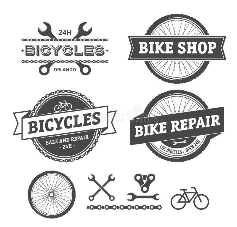 Emblèmes de boutique et de réparation de vélo illustration de vecteur