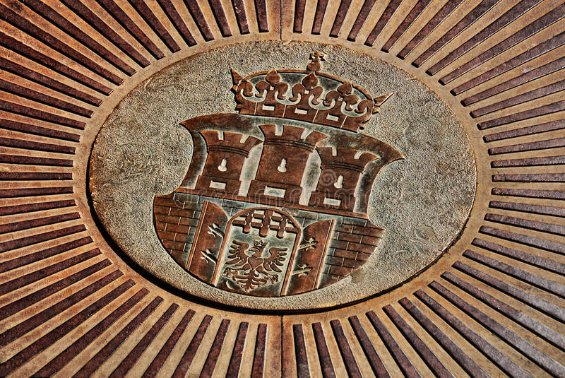 Emblem of the city of Krakow. On an iron plate royalty free stock images