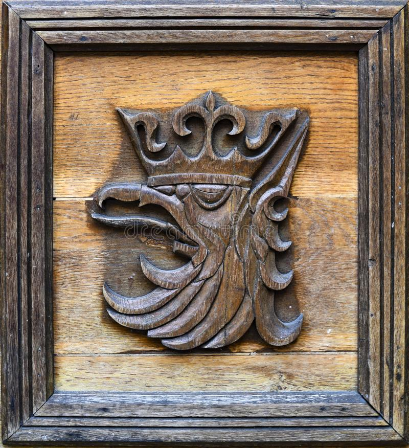 The emblem of the city of Szczecin in Poland. Wooden sculpture.  stock photos
