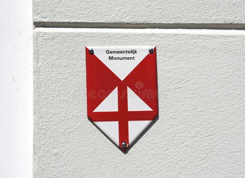 Emblem indicating a protected monument in the Netherlands. Amersfoort, the Netherlands. July 2018. Emblem to indicate a building is a monument national heritage royalty free stock photo