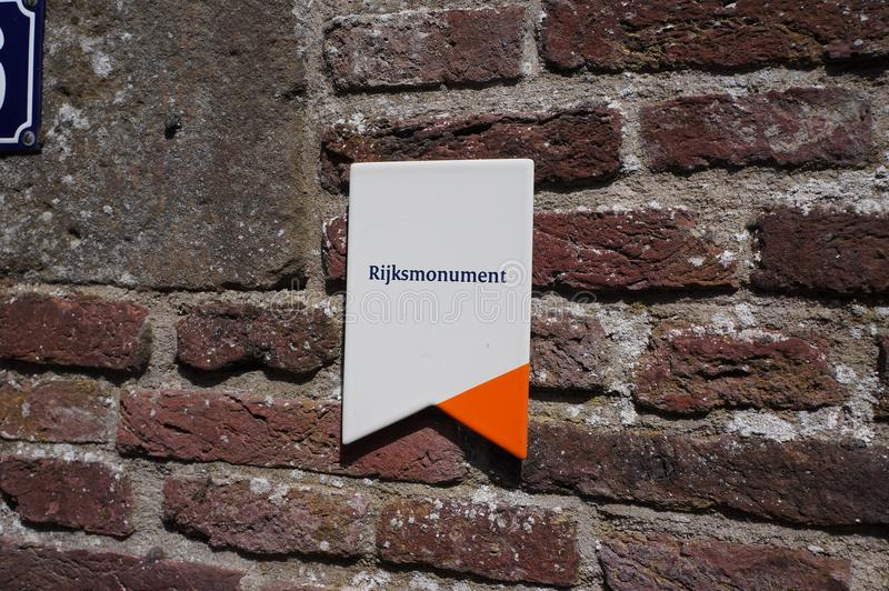 Emblem indicating a protected monument in the Netherlands. Amersfoort, the Netherlands. July 2018. Emblem to indicate a building is a monument national heritage stock photos