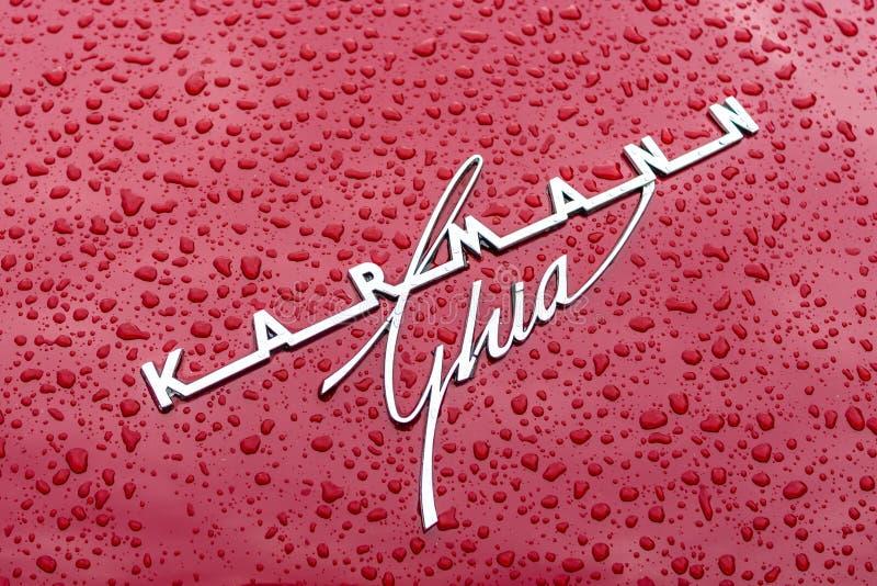Emblem of a sports car Volkswagen Karmann Ghia in raindrops. stock photo