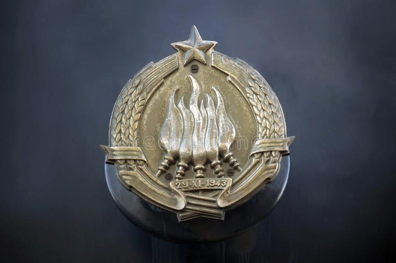 Emblem of Yugoslavia. The emblem of Yugoslavia featured six torches, surrounded by wheat with a  star at its top, and burning together in one flame. This stock photography