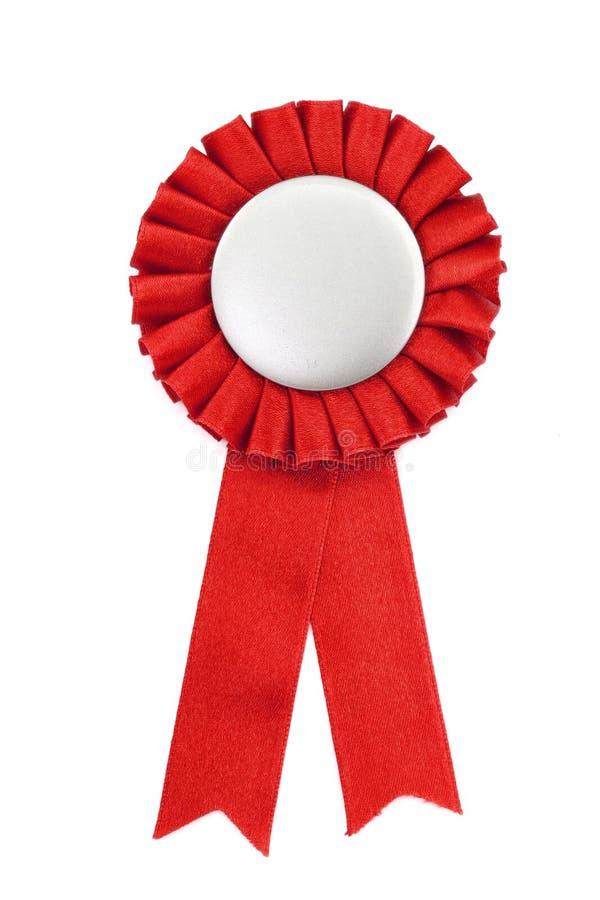 Emblema vermelho das fitas da concessão foto de stock royalty free