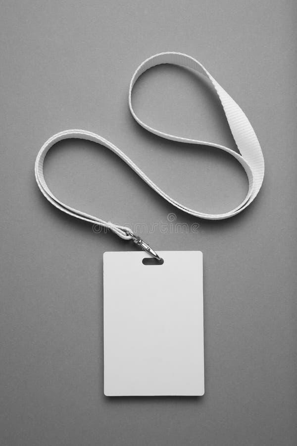 Emblemet personalID-modell, namnger etikettstaljerepidentitetskorten på grå bakgrund royaltyfria bilder