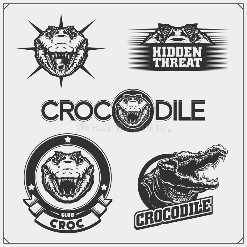 The emblems with crocodile for a sport team. Crocodile labels, badges and design elements. royalty free illustration