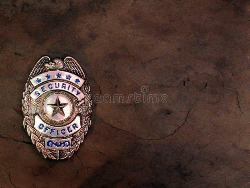 emblemtjänstemansäkerhet royaltyfri foto