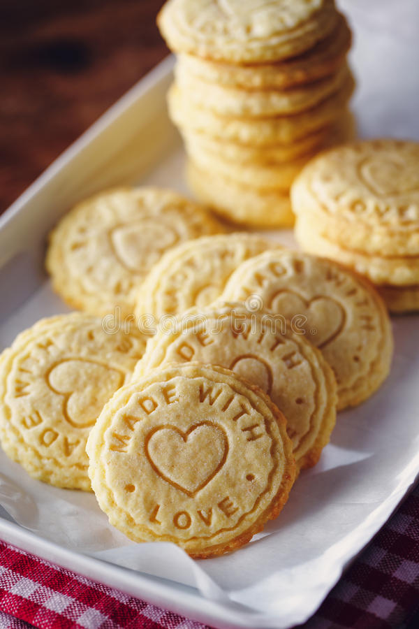 Embossed butter biscuits. Biscuits stamped with `made with love`, on plate stock photography