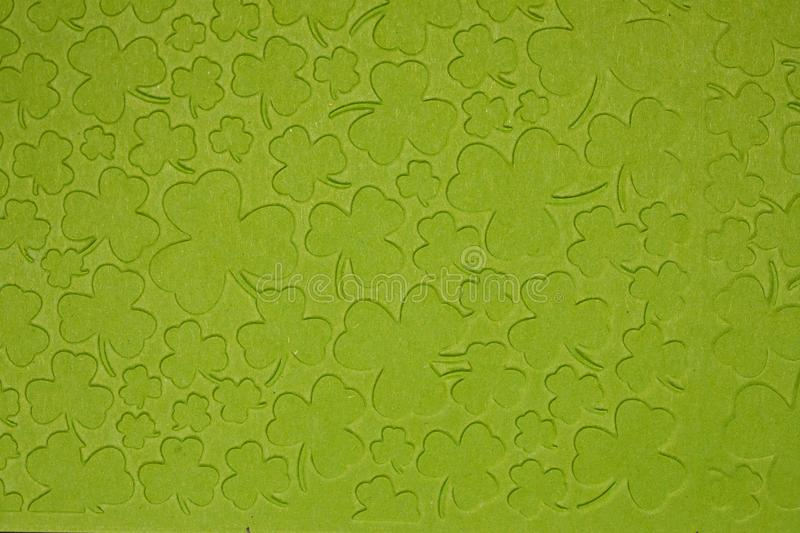 Embossed light green carton paper. Background of shamrock. stock photography