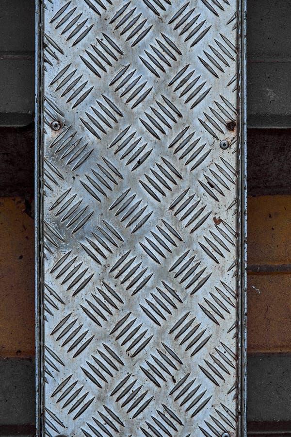 Embossed metal plate on the paving slab stock image