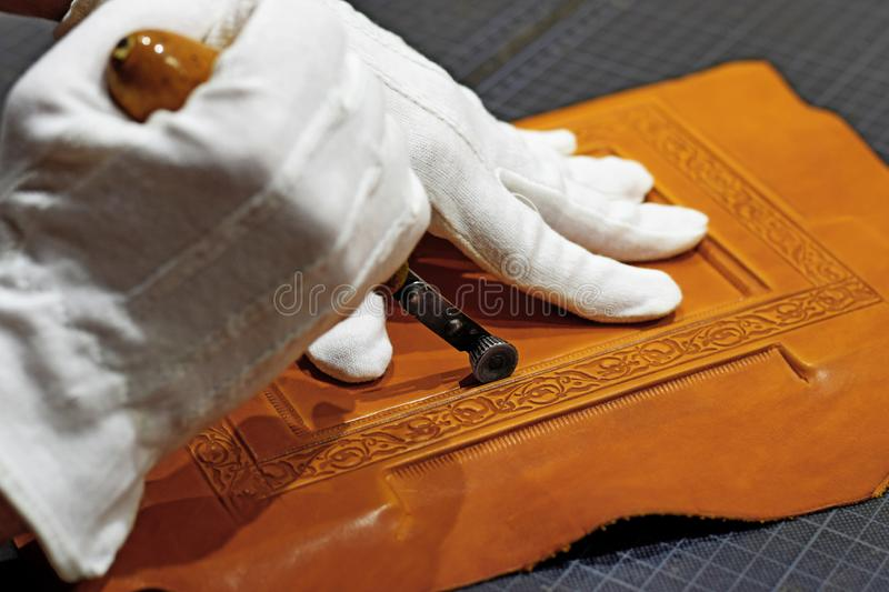 Embossing the frame with hot hand tool royalty free stock photos