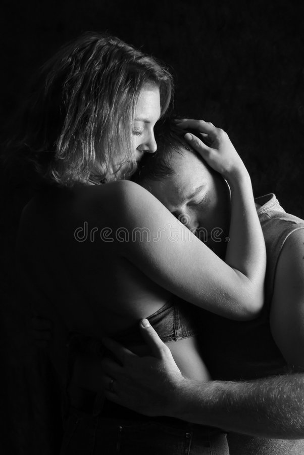Embrace. Artistic portrait of woman and man embracing stock photos