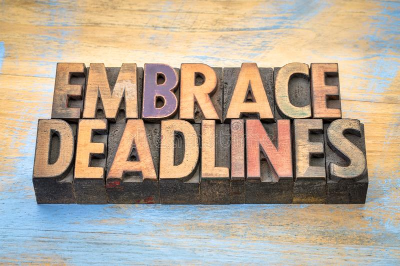 Embrace deadlines in wood type. Embrace deadlines - word abstract in vintage letterpress wood type blocks stock images