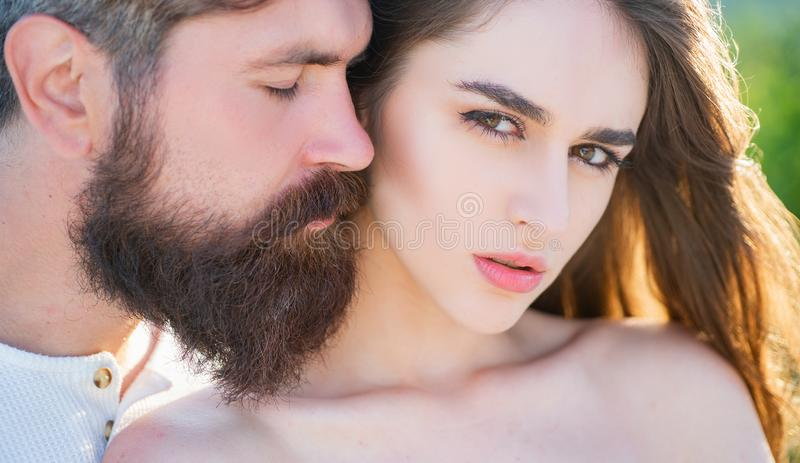 Embrace and kiss for couple in love. Young lovers couple. Beautiful young sensual woman love affectionate man. Sensual royalty free stock photos