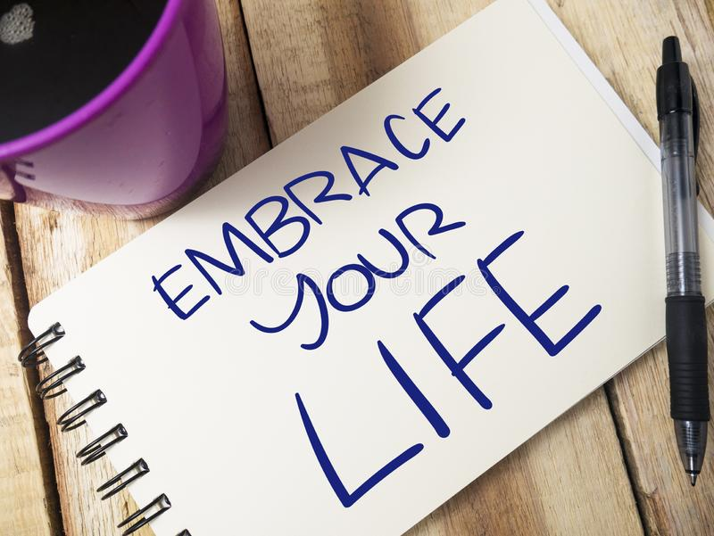 Embrace Your Life, Motivational Words Quotes Concept. Embrace Your Life, business motivational inspirational quotes, words typography top view lettering concept royalty free stock photo