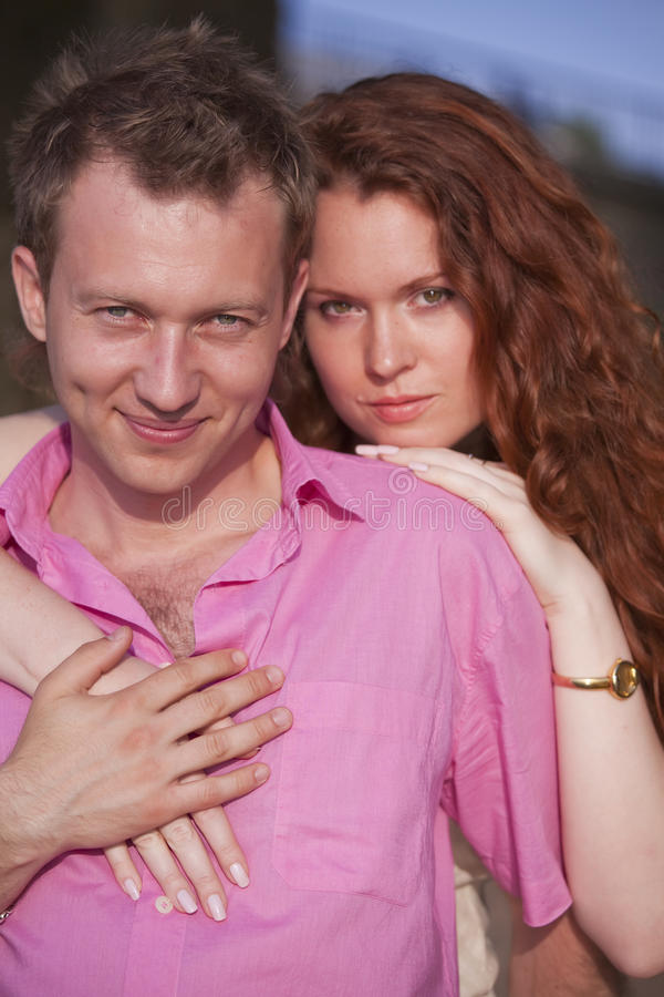 Embracing couple stock photography