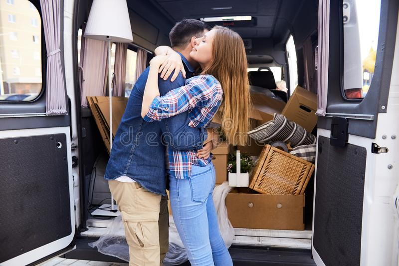 Embracing Couple Moving to new Home stock images
