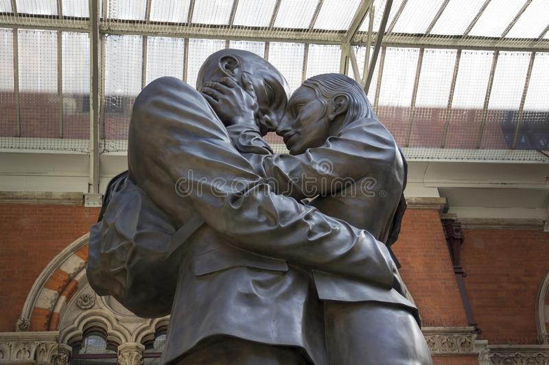 The Embracing Couple by Paul Day at the Meeting Place St Pancras International Railway Station, royalty free stock image