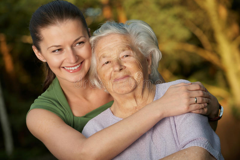 Embracing grandmother stock photography