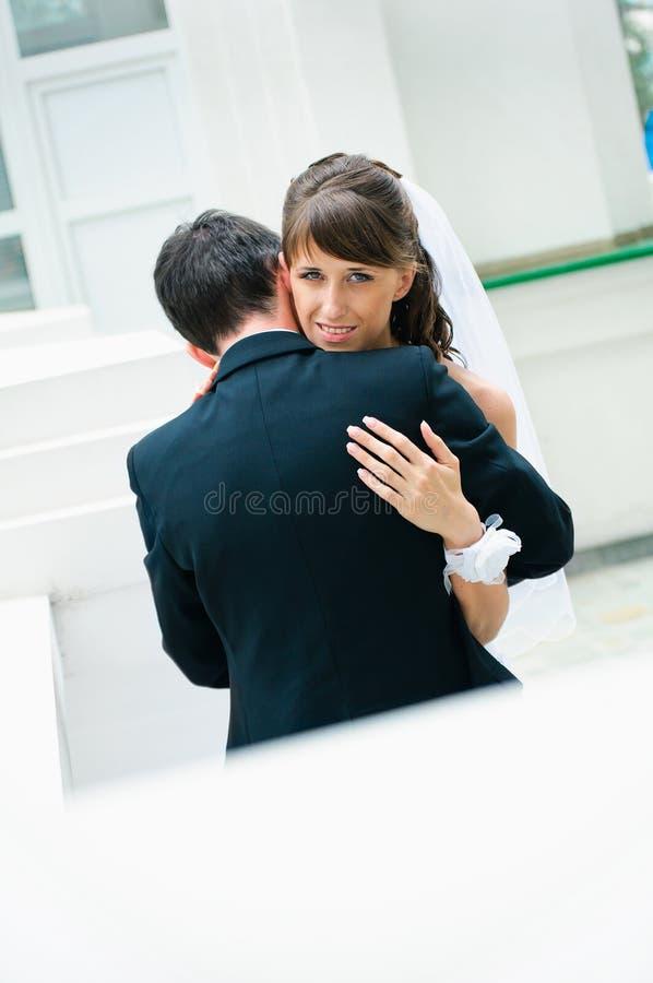 Embracing wedding couple. Bride and groom stock photo