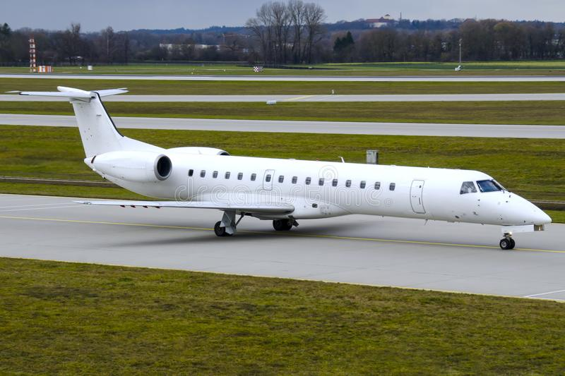 Embraer 145 aircraft on a taxiway royalty free stock photography