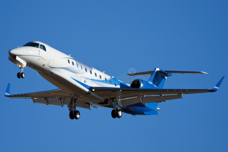 Embraer EMB-135BJ Legacy. Business jet seen landing royalty free stock images