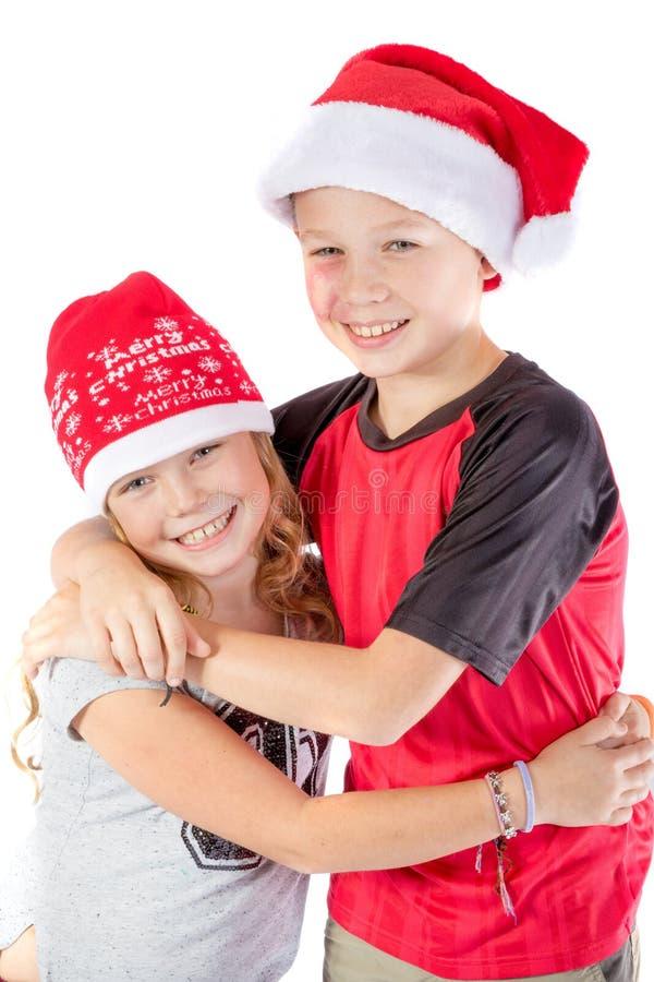 Embrance de los hermanos para la Navidad imagen de archivo