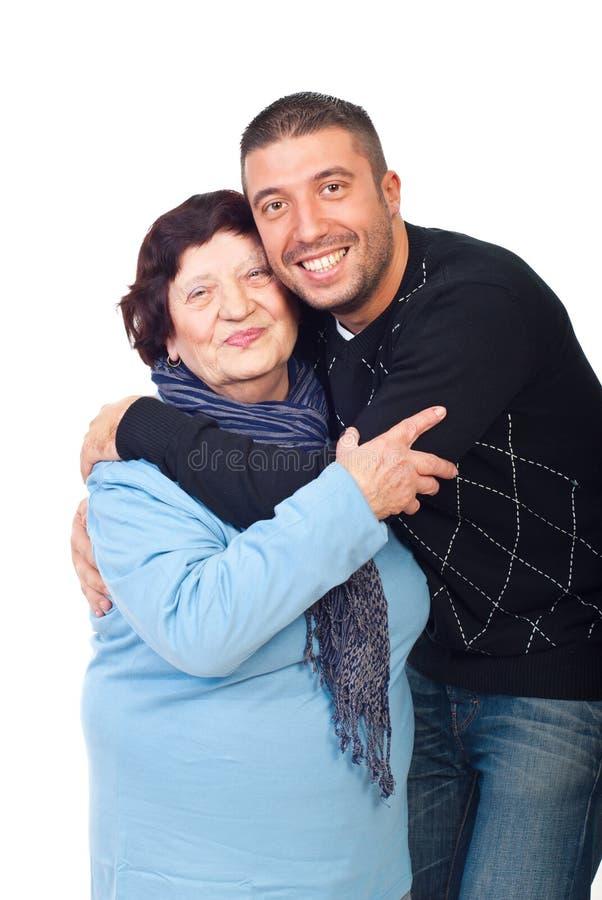 Embrassement de grand-maman et de fils photos libres de droits